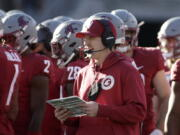 Washington State defensive coordinator and linebackers coach Jake Dickert, center, was named interim head coach on Monday.